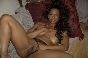 Hot mature Semmie Desoura denudes tits and rubs black pussy through panties