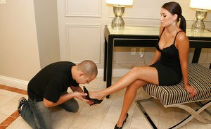 Hot mistress with beautiful long legs gets her high heels worshipped