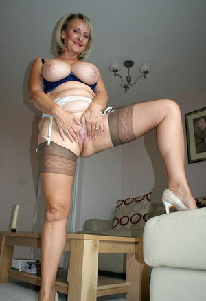 Mature fatty in stockings posing upskirt and gets a huge cock in her mouth
