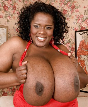 African fatty Shar Nitzapanus playing with her enormous black boobs