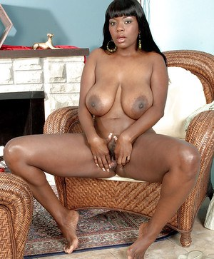 Black busty Camille Morgan spreads her hairy fanny and rubs it.