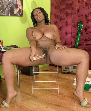 Black girl with amazing juggs Danesha Marquel toying her hairy pussy