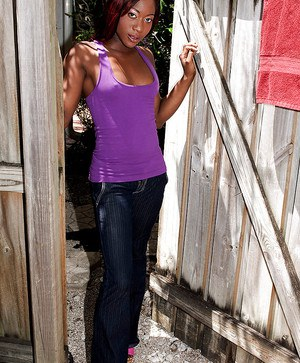 Ebony babe Giselle Capri shows off in tight jeans and high heels.