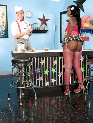 Chubby black girl Kiki Carter comes to a candy store and gets hard meat to suck