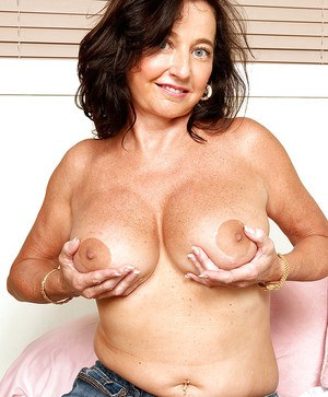 Horny amateur fatty loves showing off her mature big breasts as she strips on the sofa.