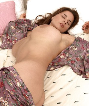 Chloe Vevrier had an erotic dream and she took off her top in sleep and showed off her big jugs.