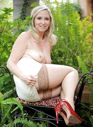 Horny mature Annabelle Brady gets naked outdoor and posing in stockings