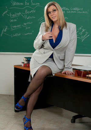 MILF fatty Sara Jay posing in lingerie like a slutty teacher.