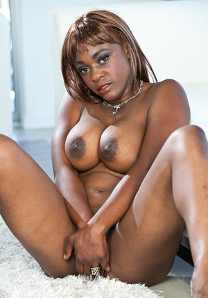 Busty MILF Coco Pink demonstrating sexy black butt and big nipples