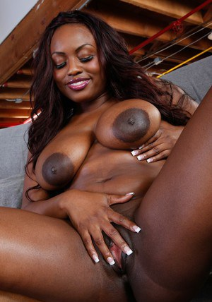 African wife Jada Fire strips down to tease her shaved pussy and tits