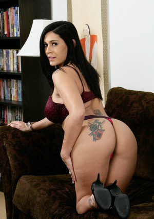 Fervent brunette MILF getting undressed and showing big tattooed ass