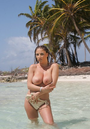 Busty pornstar Roberta Misoni brings out her puffy melons from bikini