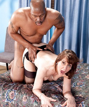 Mature slut in black stockings Elle Denay gets off in interracial sex