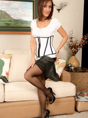 Lascivious mature brunette in nylons uncovering her jugs and unshaven cooter  1515842