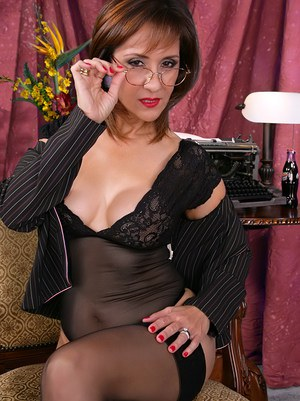 Mature woman Roni stripping her tits from black see-thru underwear