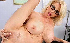 Blond teacher in glasses Penny Porsche strips and shows mature pussy