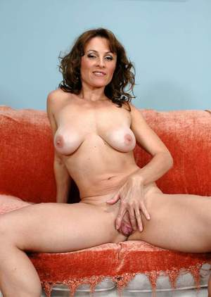 Mature lady Danielle Frost strips her goodies from jeans and lingerie