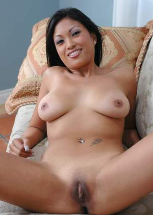 Busty asian cutie Kea Kulani stripping nude and spreading pink flaps