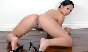 Lascivious asian lady Gianna Lynn strips completely nude and spreads