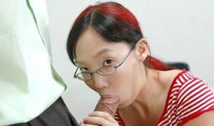 Petite asian coed in glasses strips and gets pounded hard on the desk