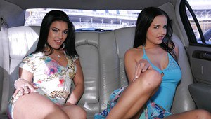 Two dazzling lesbians pulling down panties to expose gorgeous butts
