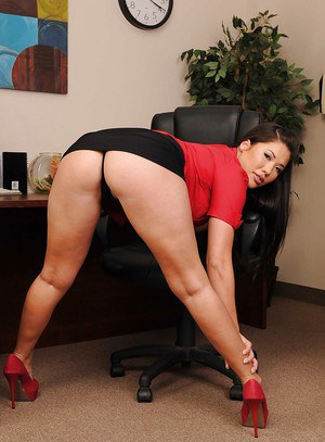 Asian babe London Keyes strips to expose her big tits in the office