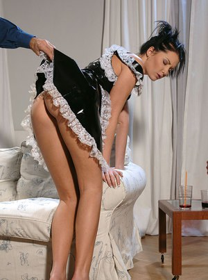 Sexy girl in fetish maid uniform gets her ripe butt spanked and caned