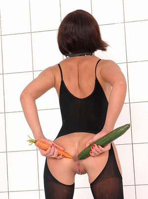 Sultry fetish babe sliding huge carrots and cucumbers in her holes