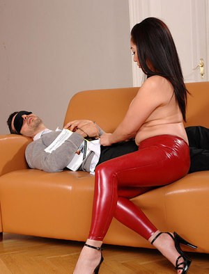 Asian babe in latex Midori Tanaka is pleasing a dick with a footjob
