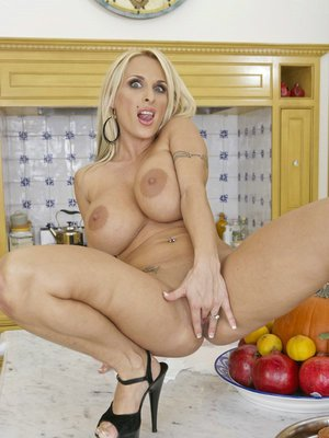 MILF pornstar with huge hooters Holly Halston fingers her wet cunt