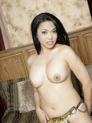 Asian MILF with big tits Mika Tan strips to expose her peachy body