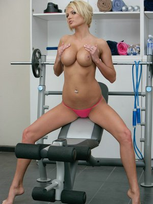 Blonde wife Hanna Hilton fingering her pussy right in the gym