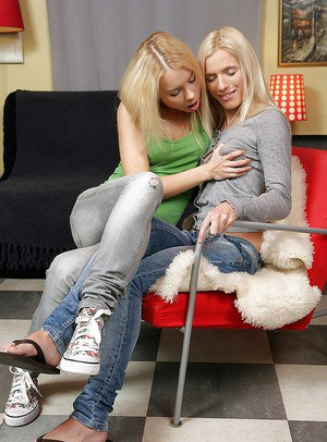 Sexy teen blondes having kinky lesbian fun with a thick strapon