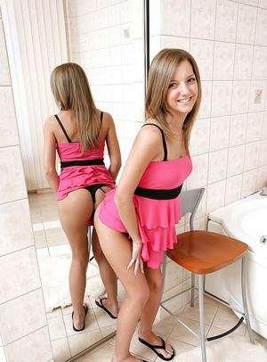 Young sexy babe strips in her bathroom and fucks her ass with a toy