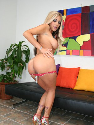 Teen babe with huge boobs Carmel Moore spreads legs and fingers pussy