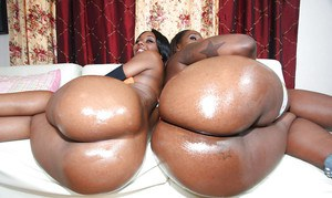 Ebony hotties Baby and Kelly show their oiled asses and pierced pussy