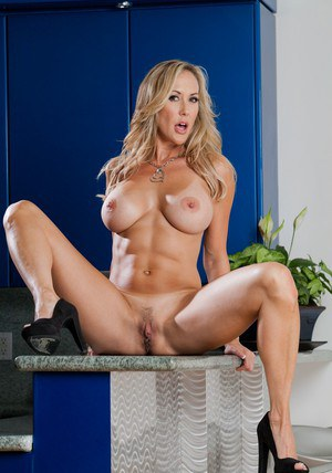 Busty MILF Brandi Love takes off her jeans and panties to pose naked