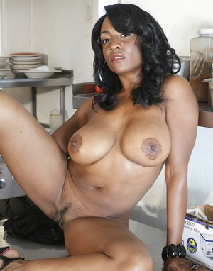 Ebony babe Sincere Lemore pulls her skirt down to show her tight booty