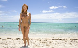 Outdoor posing of big tits milf Janet Mason in tiny bikinii