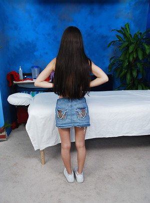 Skinny teen with tiny tits strips and lays on the massage table