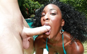 Black hottie sucking on a thick cock and fucking at the pool