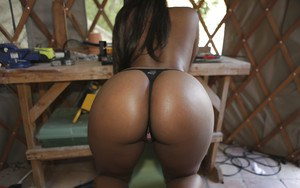 Busty ebony babe in tight shorts flashing outdoor and stripping
