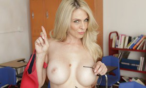 Milf teacher Angela Attison gets horny and shows her panties spreading