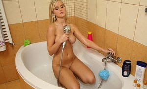Posh blonde Marry Queen fondling her delicious curves in the shower