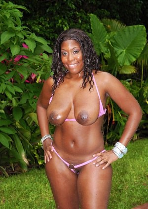 Black babe Sasha Boyce gets her tits and huge ass oiled up at the pool