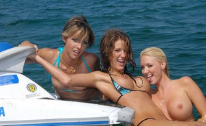 Hot lesbians with nice boobs riding on a ski jet in bikinis
