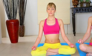 Flexible lesbian babes licking wet pussies at the yoga class