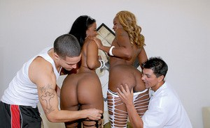 Slutty ebony girls in pantyhose are into groupsex with white guys