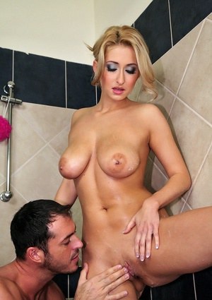 European cutie with big tits Carina gives a handjob in the shower