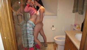 Lesbian girlfriends with ample asses kissing each other in the bath